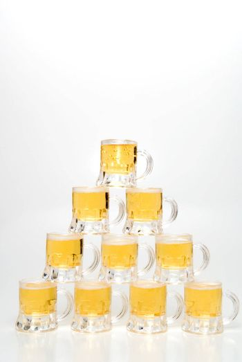 A set of Beer Mugs set up in a pyramid.