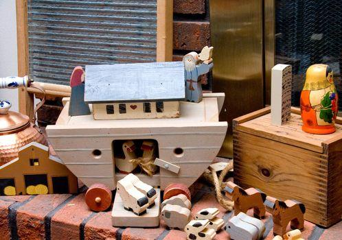 Noahs Ark Toys on a fireplace hearth.