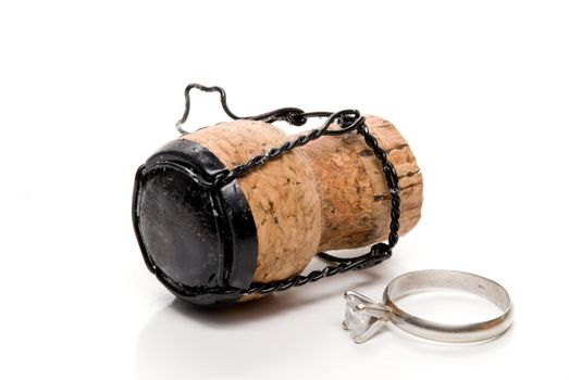 A wedding ring and a champagne cork.