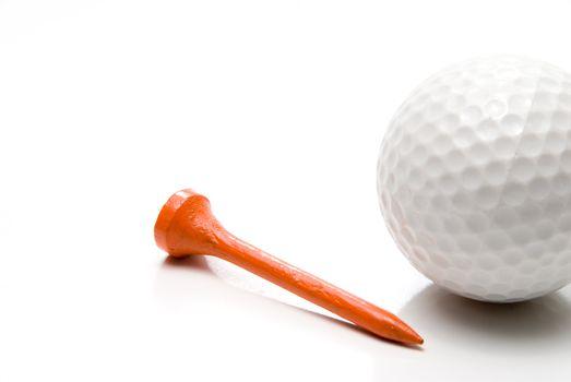 A golf ball and a golf tee.