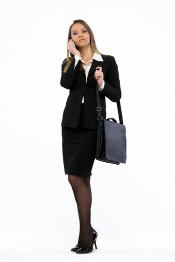 Portrait of a young attractive business woman talking on mobil phone