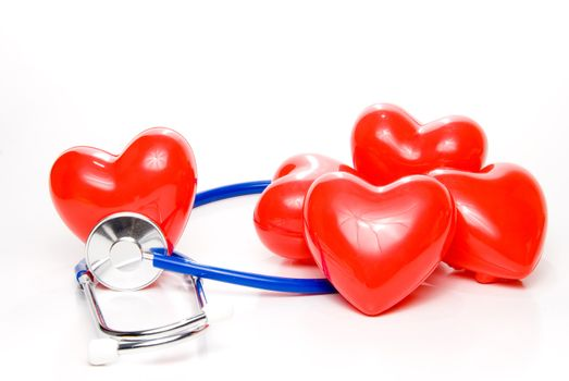 A red heart shape and a medical stethoscope.