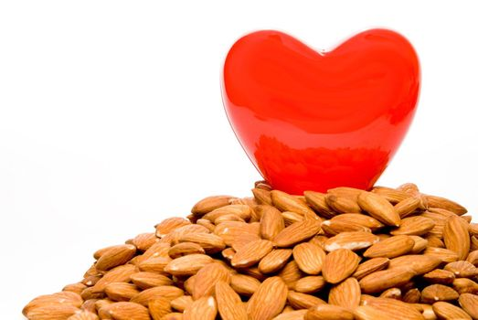 A heart surrounded by cholesterol busting almonds.