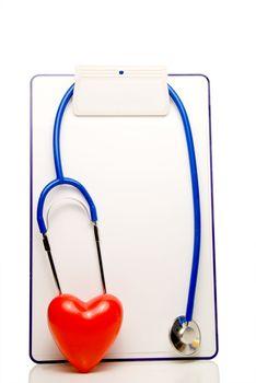 A medical chart, stethoscope and heart shape.