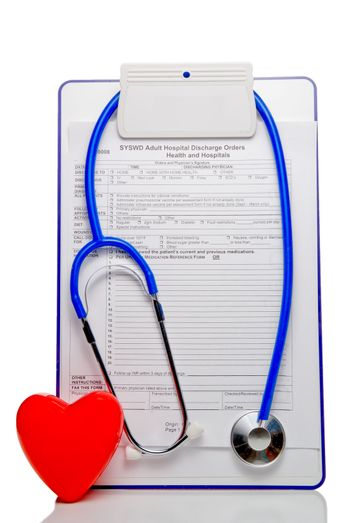 Medical discharge papers, stethoscope and heart shape.