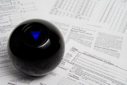 Using a magic ball to predict the outcome of a tax return.