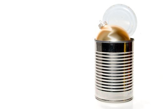 A Christmas ornament in a tin can.