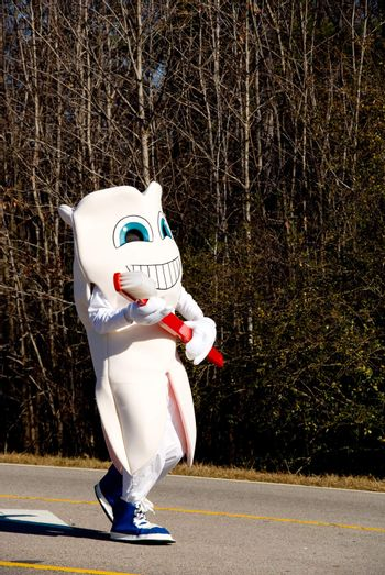 A person in a giant tooth costume.