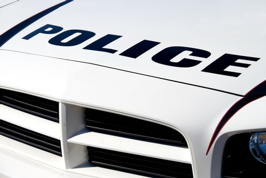 The front end of a police car.