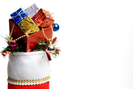 A Christmas stocking filled with holiday goodies.