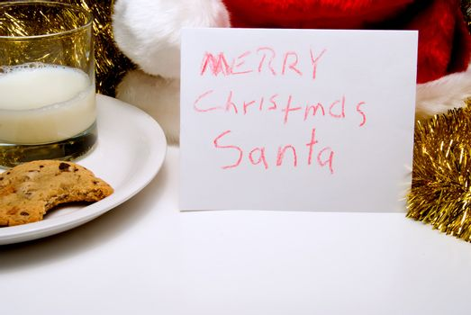 A child's note to Santa Claus on Christmas Eve.