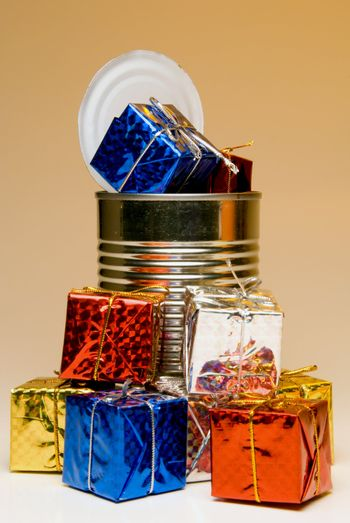 A tin can overflowing with Christmas presents.