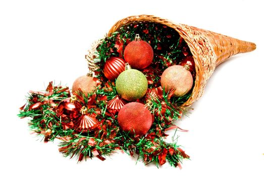 A cornucopia filled with holiday Christmas ornaments.