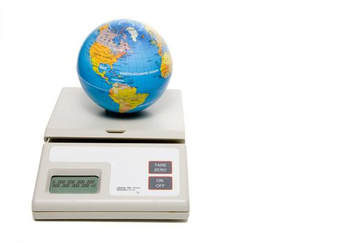The weight of the world being weighed on a scale.