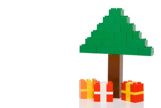 A Christmas tree made from toy building blocks.