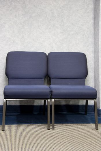 Chairs in the waiting room of a doctor's office.