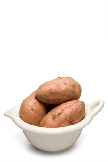 The fresh agricultural product known as the sweet potato.