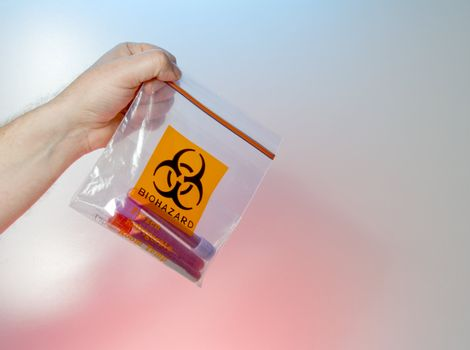 A medical biohazard bag with blood samples.
