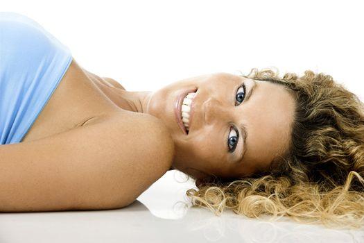 Beautiful blond woman portrait lying on the ground