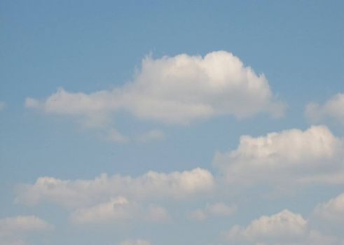 Sky with fluffy clouds, usable as background