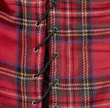 Woolmaterial  tartan-look in red with a cord