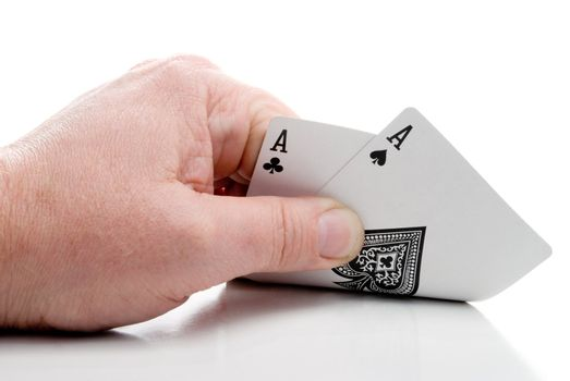 A poker player holding a pair of aces.