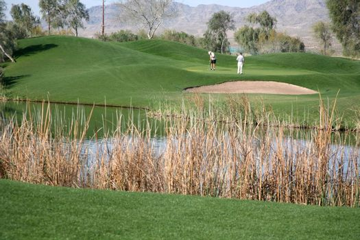 Golf course with golfers enjoying a healthy lifestyle