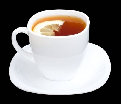 cup of tea with lemon and saucer, isolated on black
