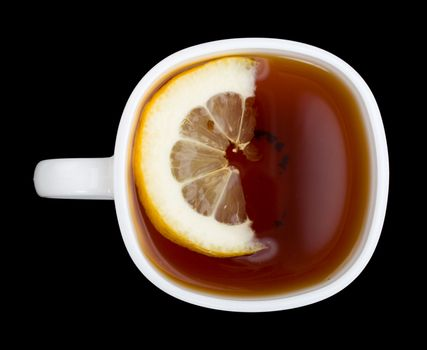 cup of tea with lemon, view from above, isolated on black