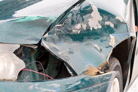 close-up damaged green car