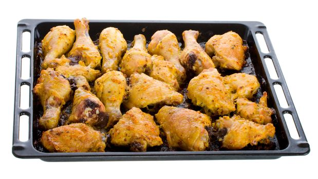 fried chicken meat on baking sheet, isolated on white