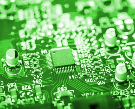 close-up microchip on green circuit board