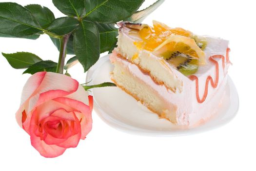 piece of cake and rose, isolated on white
