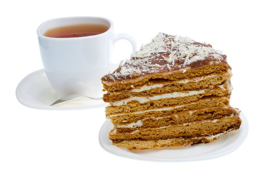 piece of honey cake and tea cup, isolated on white