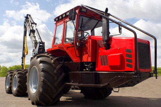 new red tractor for lumber industry