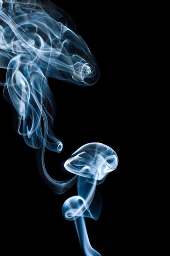 abstract blue thick smoke, isolated on black