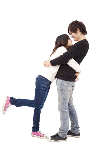 Asian couple hugging each other