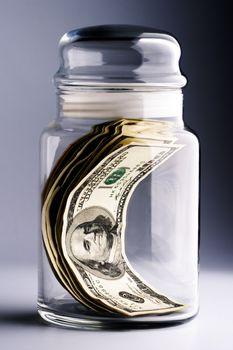 money in glass jar closeup