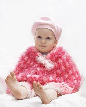 cute child in a red poncho