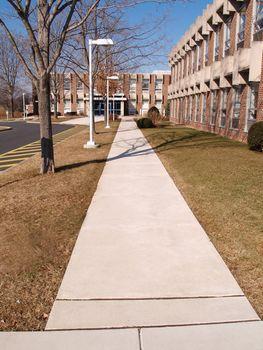 long sidewalk leading into a building