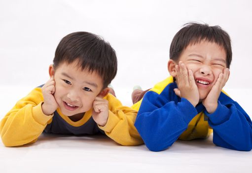 Two naughty boys,brothers.Isolated with white background.