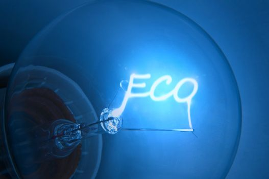 """Close up on illuminated blue light bulb filament spelling the word """"Eco""""."""