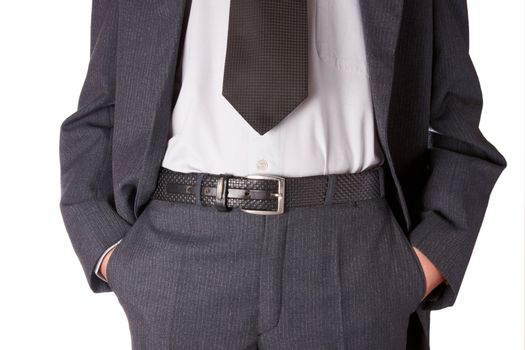 Business man in black striped suit. Hands in pockets