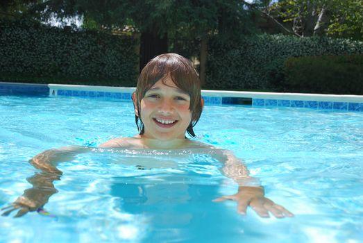 Smiling Teen Boy Swimming in Pool