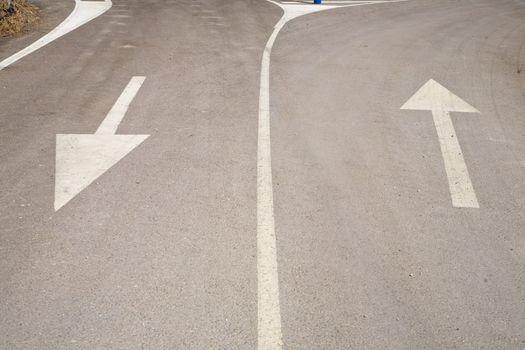 two arrows on asphalt