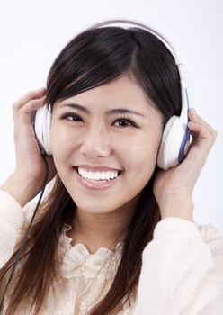 Happy Asian girl with headphone
