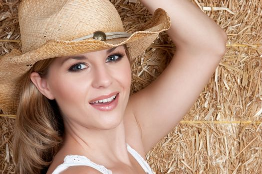 Pretty country girl wearing hat