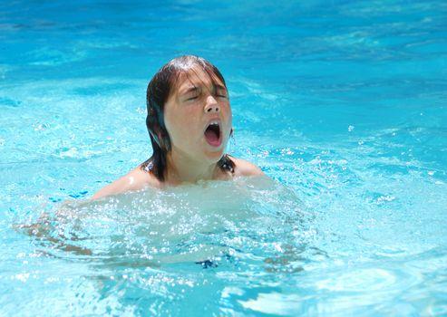Teen Boy Swimming in Pool
