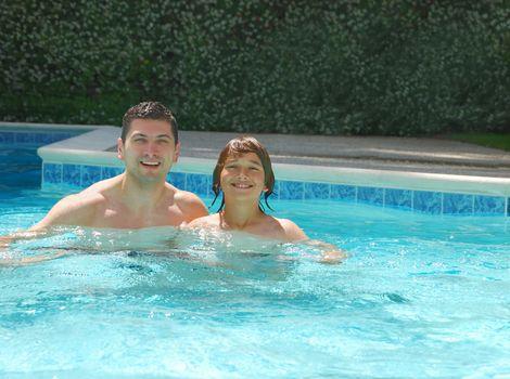 Dad and Son Enjoying Swimming Pool