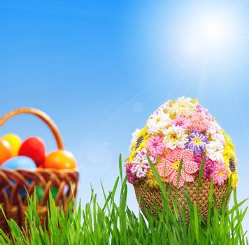 Egg decorated with beads in green grass